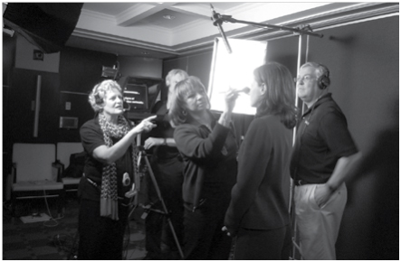 Rosemary Reed (left) supervises makeup application during a recent shoot for Double R Productions